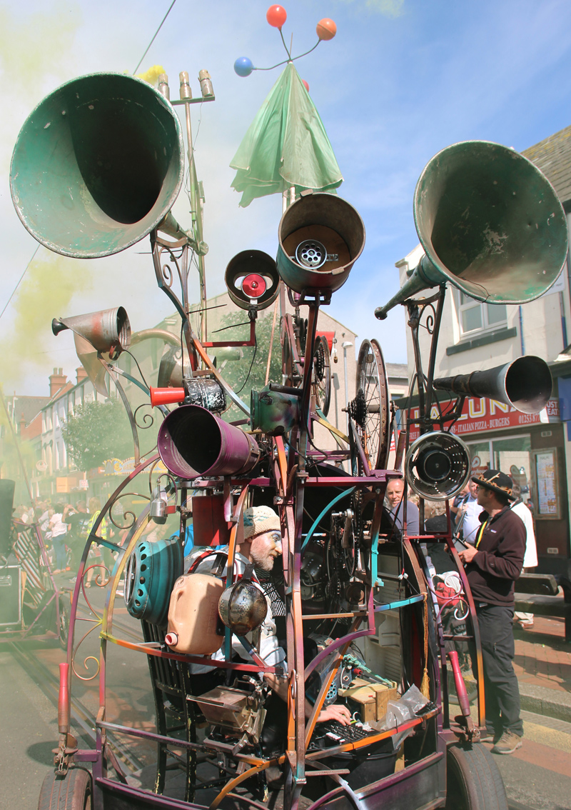 The Hurly Burly is a mobile sound sculpture, sonic amusement, twittering machine and junkyard delirium; packed with a tumultuous array of bells, sirens, alarms, whistles and mechanical percussion.
