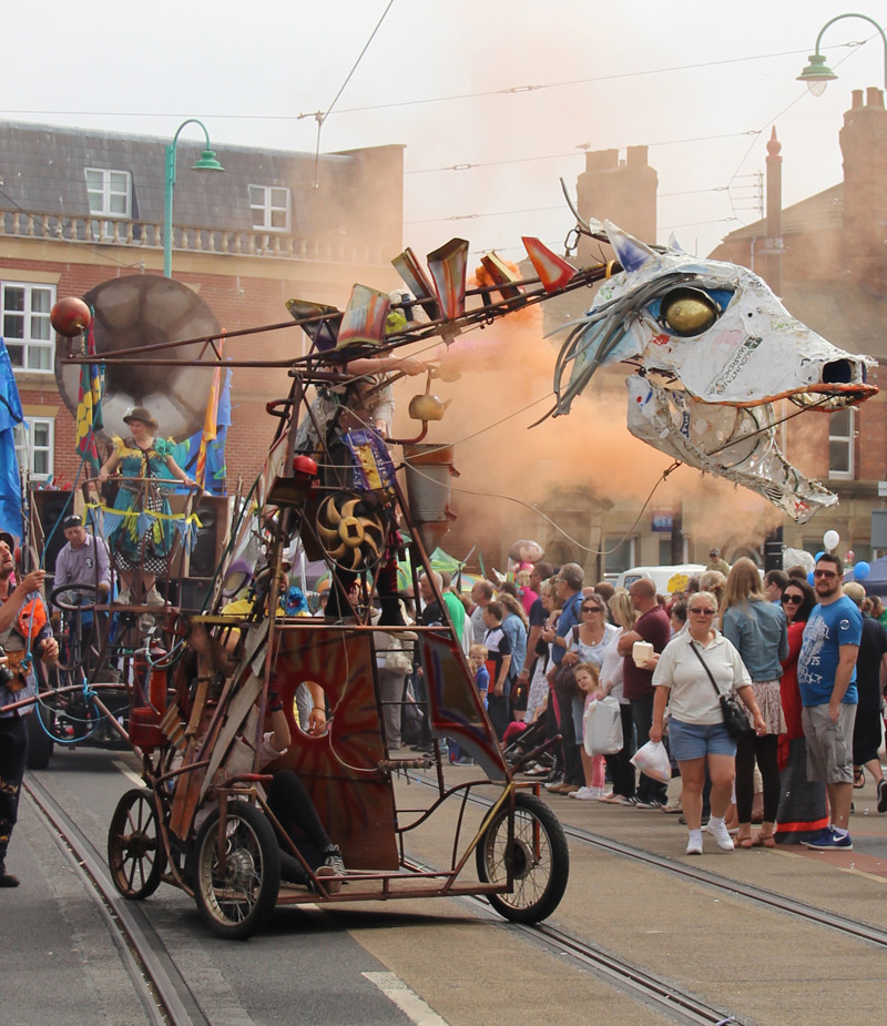 Boneyard Beast mechanical puppet roars and belches orange smoke  at the Spare Parts Festival Parade, Fleetwood, 2015