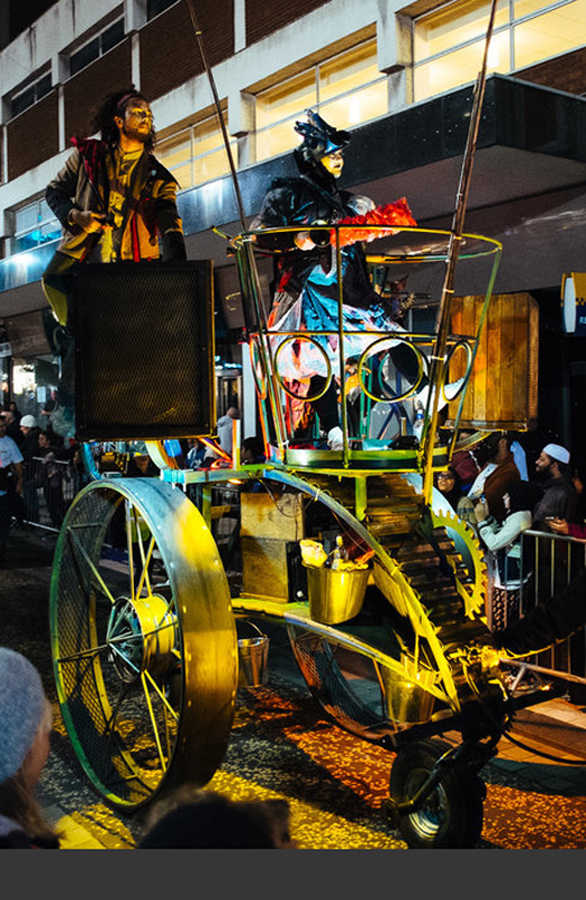 Boneshaker - mobile tower for performer and sound system at Preston Guildhall Illuminated Procession 2016. The 1.2m diameter wheels are friction driven by pedal power, allowing the Boneshaker to turn on a penny.