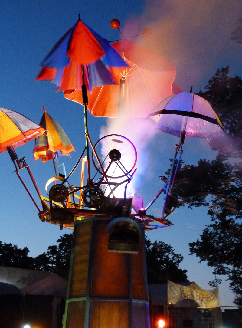 The Umbrella Tree sculpture with mechanically operated brollies lights and smoke, Wilderness festival 2018