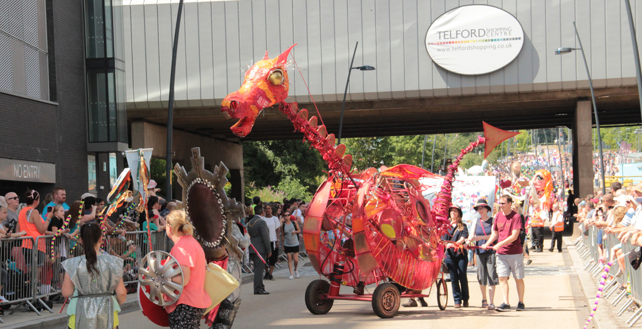 Wheeled Dragon puppet made out of scrap & recycled materials for Telford Giant Parade July 2018