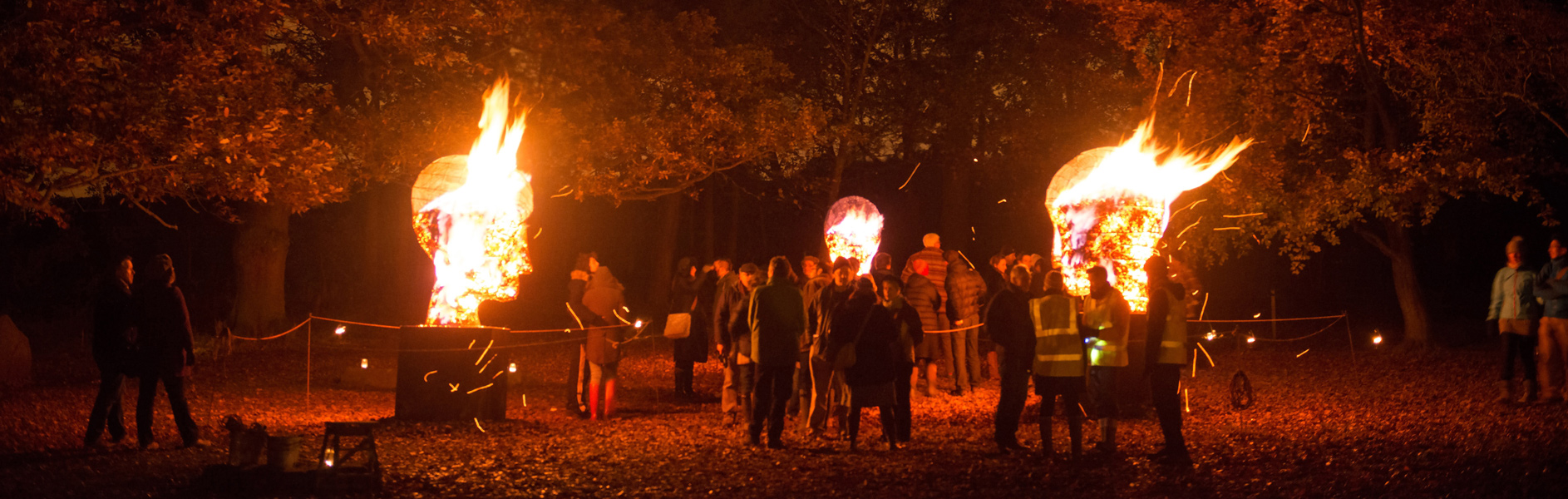 Photo of  Hot Heads in flames- an installation of three sculptural charcoal braziers designed and made in collaboration with pa-Boom. Event at Yorkshire Sculpture Park, 2013
