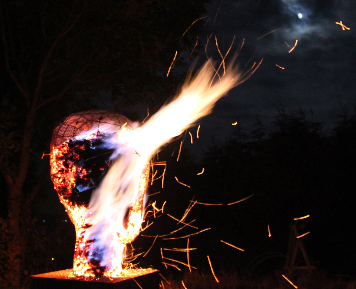 Photo of a Hot Head in flames- a sculptural charcoal brazier designed and made in collaboration with pa-Boom