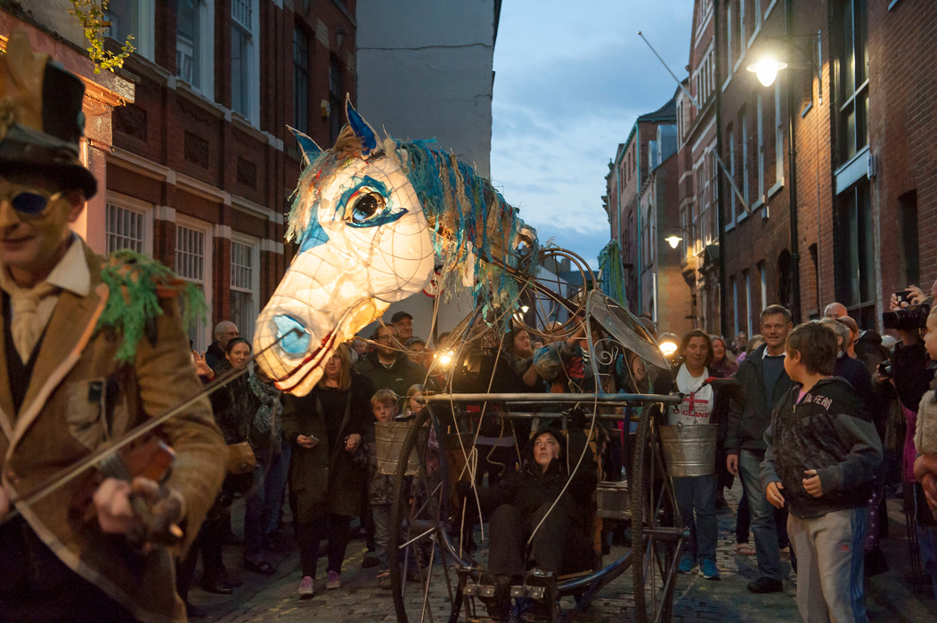 Hobby horse tricycle based puppet processes through Hull Old Town at Freedom Festival, Hull 2014