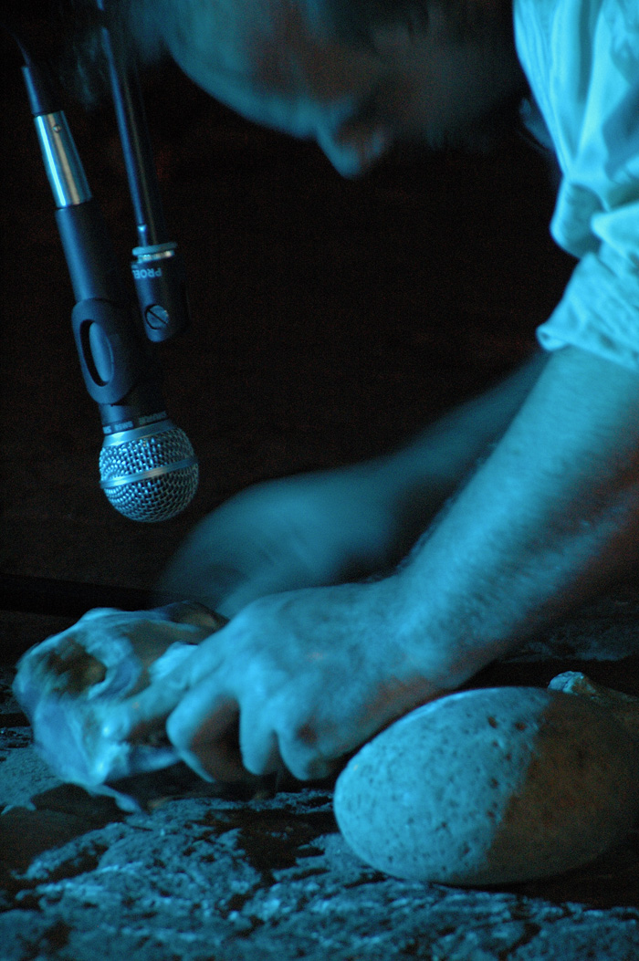 Making sounds with stones at Leviathan Whispers event, Braziers Park 2007