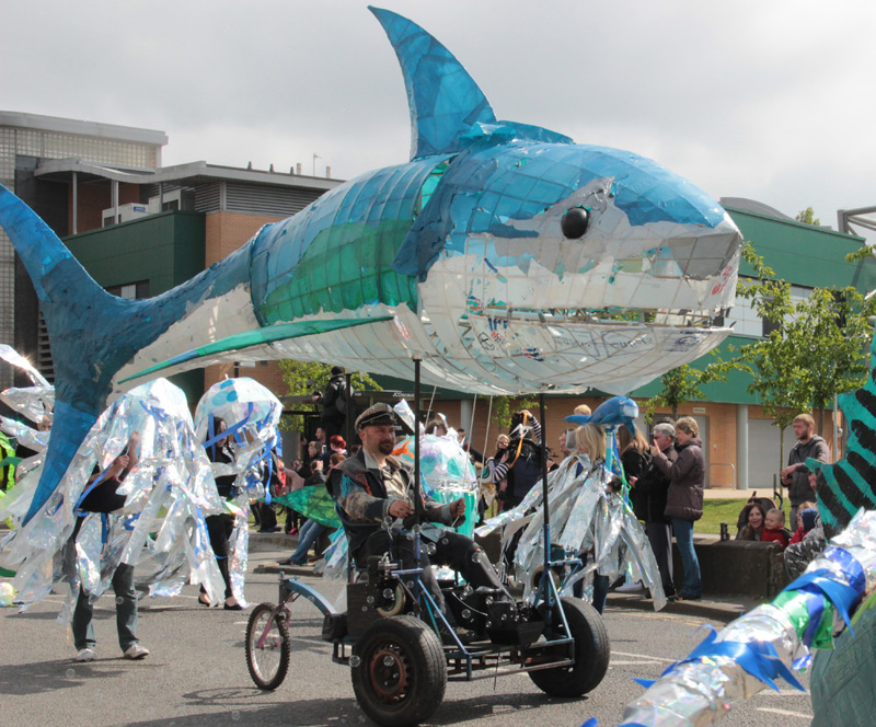 Shark, built for Extraordinary Orchard Park Parade, Hull 2017. 6 metres long, with articulated head, tail, chomping jaws, squirting water and bubbles, mounted on an electric powered 3 wheel chassis.