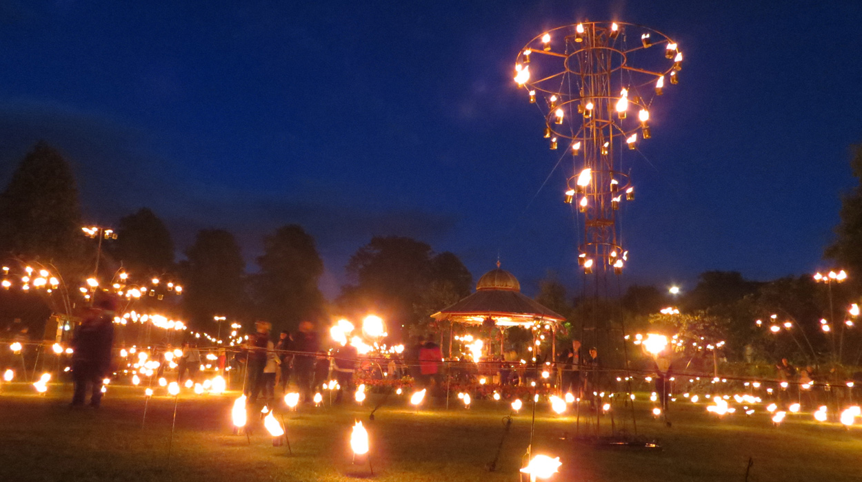 View of Fire Garden installation, showing chandelier tower of fire cans, a collaboration with pa-Boom